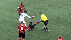 Linesman attacks football player in Russia