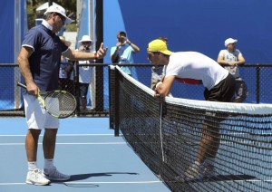 Spain's Rafael Nadal leans on the net as he talks to his coach Toni Nadal during a practice session at Melbourne Park, Australia, January 17, 2016. The Australian Open tennis tournament starts January 18. REUTERS/Jason O'Brien