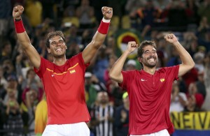 2016 Rio Olympics - Tennis - Final - Men's Doubles Gold Medal Match - Olympic Tennis Centre - Rio de Janeiro, Brazil - 12/08/2016. Rafael Nadal (ESP) of Spain and Marc Lopez (ESP) of Spain celebrate after winning their match against Florin Mergea (ROU) of Romania and Horia Tecau (ROU) of Romania. REUTERS/Kevin Lamarque FOR EDITORIAL USE ONLY. NOT FOR SALE FOR MARKETING OR ADVERTISING CAMPAIGNS.