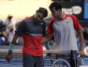 Rafael Nadal of Spain, right, talks with Grigor Dimitrov of Bulgaria at the net after Nadal won their quarterfinal at the Australian Open tennis championship in Melbourne, Australia, Wednesday, Jan. 22, 2014.(AP Photo/Andrew Brownbill)